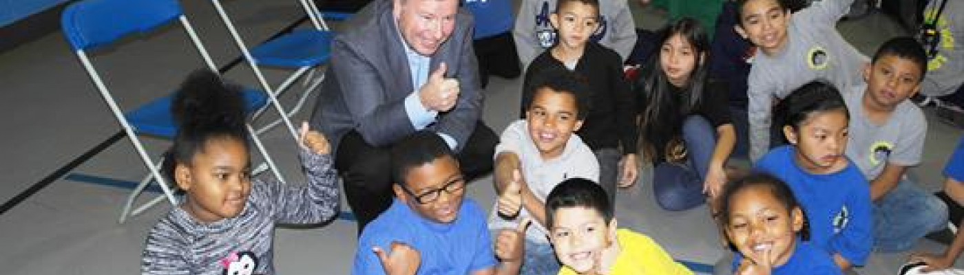 Congressman Lamborn sitting with children